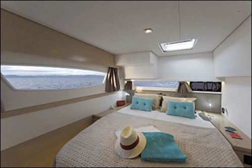 A bed inside one of the sleeping cabins on the Libra yacht, part of the &Beyond Yacht Charters fleet