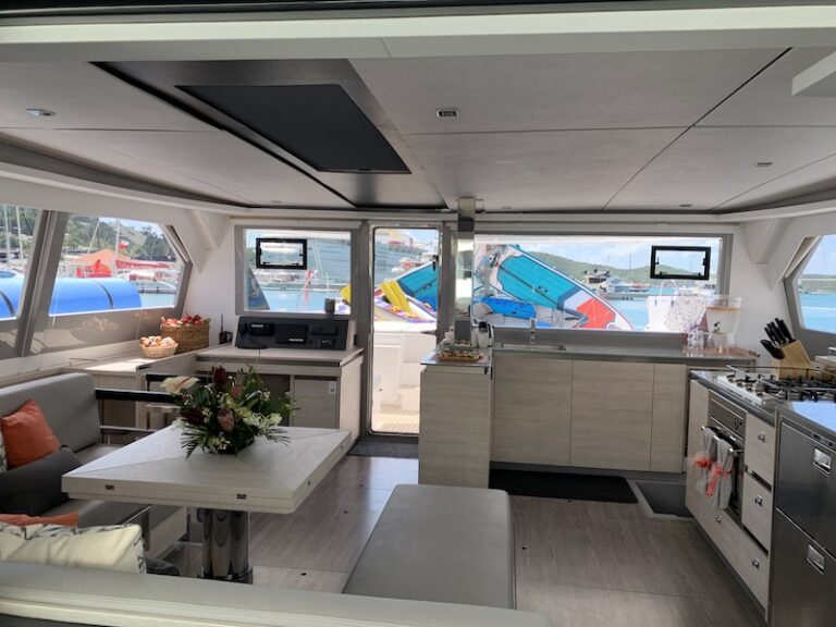 View of the galley from behind the dining area aboard the Sea Dog private yacht