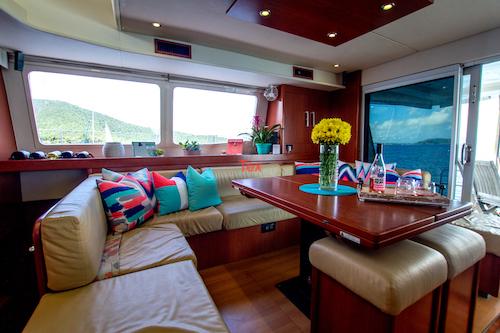 The dining area aboard the Dolphin Daze catamaran charter