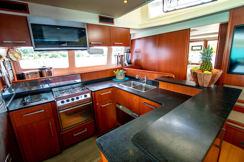 The galley aboard the Dolphin Daze yacht chartered by &Beyond Yacht Charters