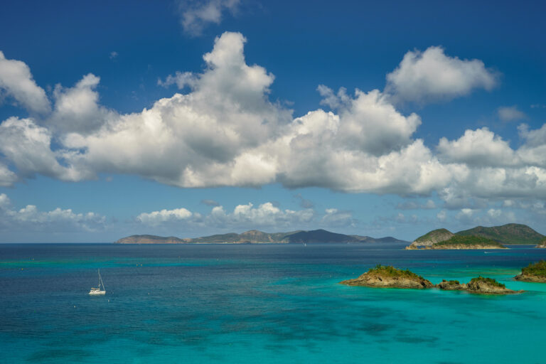 Beautiful sea in the Spanish Virgin Islands with sailing yacht and small island foreground