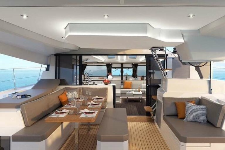 The dining area with a table set for six aboard the Hero's Journey yacht