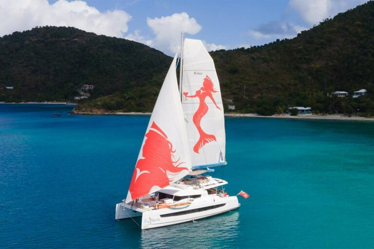 Big Nauti catamaran yacht sailing in a bay in the USVI
